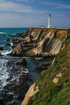 Point Arena Lighthouse, Northern California. This lighthouse has some breathtaking views and if you time it at the right time of year you might catch some whales or dolphins in the distance. The lighthouse is also one of the few that has boarding so you can spend the night and listen to the waves all night. Hauntingly beautiful.