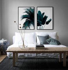 modern Scandinavian living room with a minimalist white linen sofa | IKEA Stockholm rattan coffee table | modern palm tree print from Desenio | IKEA Söderhamn sofa with a Bemz slipcover in Absolute White Rosendal linen