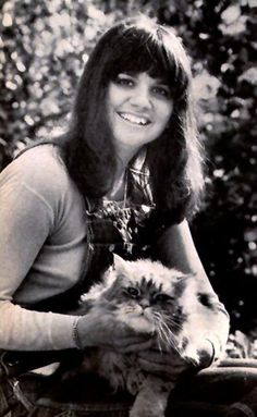 Young Linda Ronstadt and cat