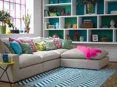 Turquoise chevron rug and neon pink throw