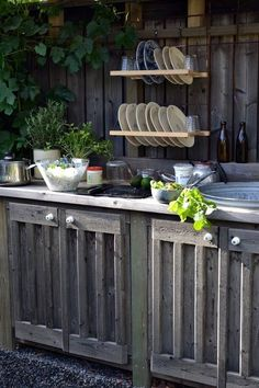 Rustic Outdoor Kitchen - I love the cabinet doors and the plate drying/keeping rack