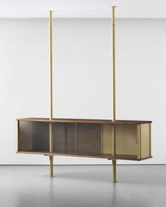 Jean Prouvé | Unique suspended cabinet, designed for Ferembal House, Nancy 1948 Painted steel, painted tubular steel, oak, glass.
