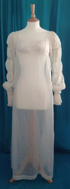 1805-1810 fine white muslin gown. Long Juliet/ Marie/ Mameluke sleeves, ruched with lace inserts and fastening with button at wrist. Slight train. Ties at back.