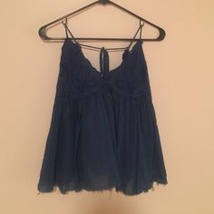 Free people navy tank that has only been worn once Free people in really good condition Free People Tops Tank Tops