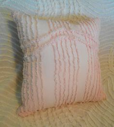 This listing is for one lovely chenille pillow. Pillow is handmade from chenille from vintage chenille bedspread fabrics. Chenille adds soft color and texture for any room in your home. Throw them on your couch, accent a chair, or pile them high on your bed. Pillow has a floral appliqued center in colors of soft peach and green. The back (shown in picture #5), of the pillow has the same lovely pink chenille as on the front.  Pillow measures 12 x 12 stuffed. I measure from the middle of the…