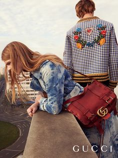 Captured in the new Gucci Spring Summer 2016 campaign, a tie-dye denim trench, cherry red GG Marmont messenger, and a check sweatshirt with embroidered patches.