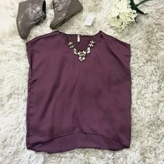 Silky Tee - Frenchi (Juniors) Sz Small Frenchi silky Purple - Eggplant Short-Sleeve top with an asymmetric hem. Silky, draped fabric enhancing the styles relaxed fly. Great top to pair with jeans for a more dressed up look! Shorter in the front with a bit of a longer tail. Never worn. Originally purchased from Nordstrom BP department. Feel free to ask questions!  Frenchi Tops