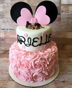 Adorable Minnie Mouse baby shower cake.  Fondant baby topper. Rose cake. Pink Minnie Mouse cake