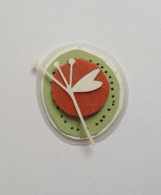 brooch made from recycled material; plastic from the beach, plastic milk carton and lazercut paper by Josephine Gomersall designs