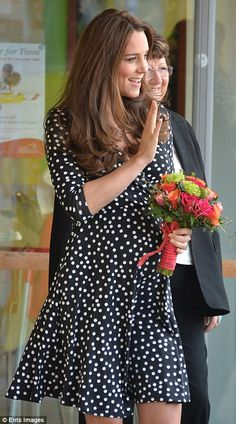 Catherine, Duchess of Cambridge was handed a beautiful bunch of roses as she left the Brookhill Children's Centre in Woolwich March 18, 2015 in London, England after enjoying a coffee morning with families.