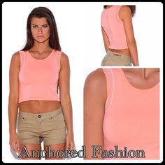"""Peach Crop The mesh detailed shoulders and bold color and versatility of this crop make it a must for your summer wardrobe! Pair with high wasted cut-offs, a skirt or yoga pants. It's fitted and stretchy. Unlined. 95% Cotton, 5% Spandex. Model is wearing a Small. She is 5'9"""", chest 32C, waist 25"""" and hips 35"""". Tops Crop Tops"""