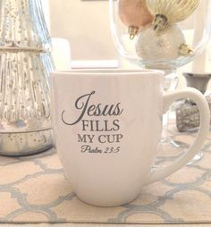 "Spend time in the word while you sip your favorite beverage from our ""Jesus Fills My Cup"" 16oz Bistro Mug. White mug with grey lettering. Psalm 23:5 You prepare a feast for me in the presence of my en"
