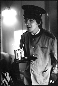 Bill Eppridge, 1964  George Harrison wearing a train porter's jacket on his way to Washington D.C.