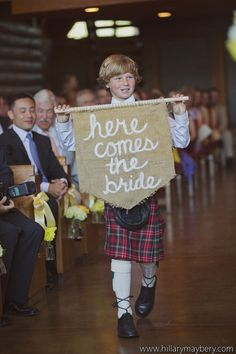 ring bearer in kilt announces the bride