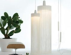 White statement pendant lights with dancing cotton strands