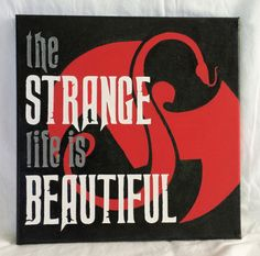 Acrylic painted Tech N9ne logo with quote The Strange Life is Beautiful.  Canvas is 12x12.