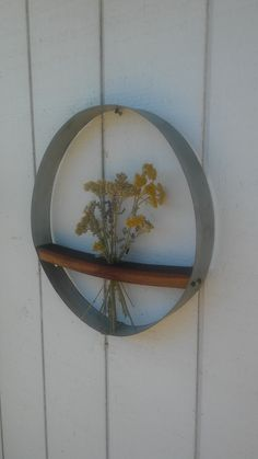 New item created from wine barrel ring and stave piece. Great for displaying fresh cut flowers from the garden, or dried arrangements.