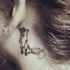 fox tattoo behind ear