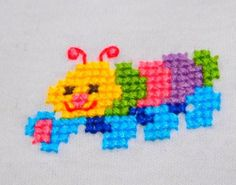 $14.95      Caterpillar     Size 00  White Long Sleeve T-shirt hand sewn with a cute and brightly colorful caterpillar any child will love.  Matching pants can be made to order.  Would make a perfect baby shower gift.  Sized to fit  height 68cms  weight 8kg.