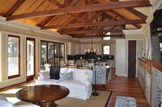 stained wood doors and windows with painted trim/wood ceiling/wood floor.    Crosby Residence - contemporary - living room - charleston - Frederick + Frederick Architects