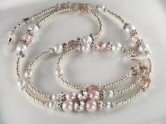 http://www.etsy.com/listing/92878704/eyeglasses-holder-antique-pearl-beaded