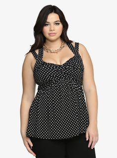 Oh, we can tell you're going to look spotless in this polka dot tank. This black and white style has contemporary appeal. Front ruching and a crisscross back add fun detail while a form-fitting v-neck bodice completes this look with a hint of sexiness.