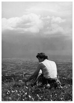 Julia Child sitting on a hillside in Alsace, 1955.