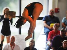 Ames' Jayna Misra executes a dive during the Little Cyclones' dual-meet victory against Fort Dodge on Tuesday in Ames. Photo by Nirmaledu Majumdar/Ames Tribune http://www.amestrib.com/sports/20160913/girls-swimming-ames-coasts-to-win-over-fort-dodge