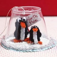 LOVE this one -- so cute!  DIY snow globe...think of all the things/pictures etc you could put in there! Penguin Ornaments, Globe Ornament, Penguin Craft, Ornament Crafts, Xmas Crafts, Fun Crafts, Kids Ornament, Wood Crafts, Kids Winter Crafts
