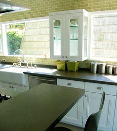 Image above: Eve Weinsheimer's green Heath Ceramics backsplash wall  DesignSponge