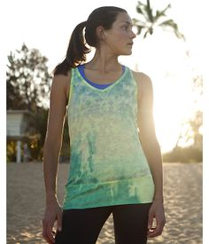 Be Calm Tank. Stand out in the studio wearing our eye-catching performance #yoga #tank #top featuring an abstract burnout-houndstooth print. The wide-banded hem with ruched sides rests comfortably on the hips, extending past the top of low-riding yoga pants. Eco-conscious #recycled #polyester fabric is enhanced with VaporWick® moisture-management technology to keep you dry when you're on the mat.