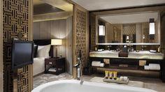 A luxurious Carlton Suite at The Ritz-Carlton, Hong Kong features fully marbled bathrooms with separate bathtub and shower and world-class bathroom amenities.