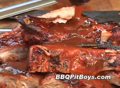 """Cola marinated Spare Ribs cooked """"low and slow"""" on the grill and then served with a side of Barbeque Beans makes for some real good eatin'. And, it's real easy to do as shown by one of the BBQ Pit Boys!"""
