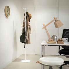 The elegant Slide series embellishes any entrance. The flexible Slide G coat stand comprises two white powder-coated metal tubes. The six plastic hooks can be mounted in various positions. Need more hanging space? Then the Slide G2 and G3 are the answer. http://www.van-esch.com/en/products/coat-stand/coat-stand/slide-g