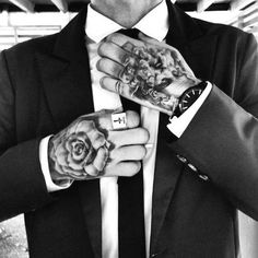 I love this image. The difference between the two tattoos is awesome yet they are both equally well done. I personally want two white roses like that on my hands.
