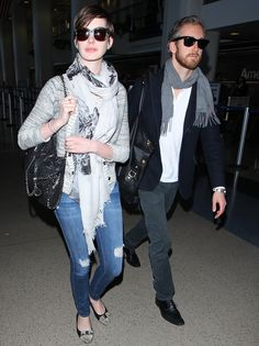 Anne Hathaway and Adam Shulman make their way through LAX airport in Los Angeles on May 13, 2013