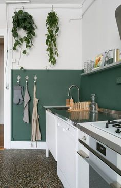 a half-painted dark green wall is used as a backsplash and adds a colorful accent #greenkitchen