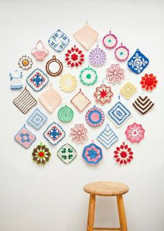 Collection of colorful vintage crochet pot holders look amazing hung on the wall!