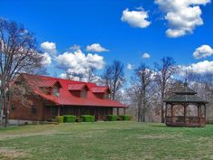 Genuine Log Home, 35 acres m/l, 4 bed, 3 bath, 3 car lower level garage, 95x55 shop, hot tub, chicken coop, pond stocked w/catfish, metal roof, geo thermal, bring the horses! in Gepp, AR.