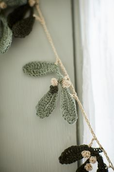 Crochet Pattern Flowers free pattern-Mistletoe Garland at Loop London Crochet Christmas Garland, Christmas Bunting, Christmas Crochet Patterns, Holiday Crochet, Crochet Home, Diy Crochet Garland, Knitted Christmas Decorations, Christmas Flowers, Yarn Crafts