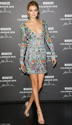 Beautiful and bright: Gigi Hadid stood out in a low-cut, lacy blue and beaded floral dress at the 2015 Pirelli Calendar Red Carpet event in Milan, Italy on Tuesday