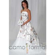 A-Line strapless wedding gown with top band and net lower-skirt. *For added fullness, the dress shown is being worn with a drawstring slip.  Sizes 2-30. Pictured in True Timber Snowfall and White Net.  Available in all camo patterns and many net colors. Made in the USA.