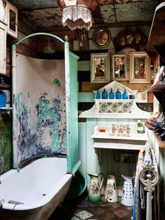 Unique Bathroom with Claw Foot tub, tin ceiling cast iron sink, vintage bathroom.