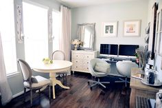 mix of wood and white painted furniture + dark hardwood + light gray walls