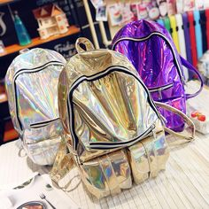 Holographic gold and silver backpack sold by Dejavu Cat. Shop more products from Dejavu Cat on Storenvy, the home of independent small…