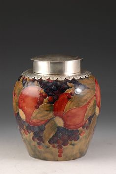 Moorcroft ginger jar, Pomegranate pattern, with sterling silver mounted shoulder and cover, made for Liberty of London, 1912