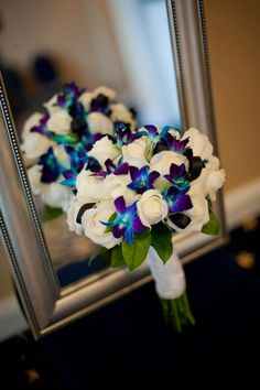 white roses and blue orchids