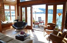 """While some of these unusual home types suggest some degree of isolation, houseboat-dwellers are typically part of a tight-knit community, sharing the harbor and a culture that seems romantic and free to a landlubber. And while many houseboats are small, some of them are downright luxurious, like Sue's Simply Stunning Houseboat, in Seattle. Would you ever leave terra firm and live here?"""