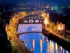 River Liffey and Dublin at night. Dublin is a lively city at night. Don't stay in the Temple Bar area hotels . unless you plan to party till . too noisy if you prefer to sleep in the evening. Places Around The World, Oh The Places You'll Go, Places To Travel, Places To Visit, Dream Vacations, Vacation Spots, Beautiful World, Beautiful Places, Beautiful Sites