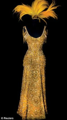 Barbra Streisand's iconic ''Hello Dolly!'' gown. Isn't it fabulous? I read somewhere that there is real gold in the thread and that this dress was one of the most expensive movie costumes ever made. This one's part of the auction.